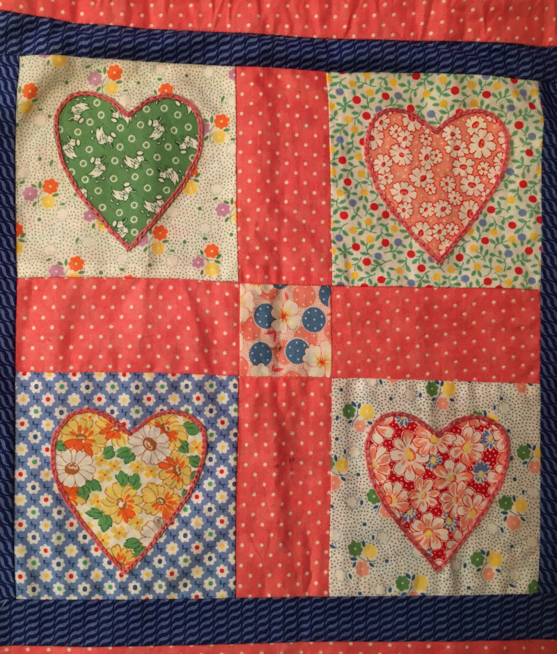 Close up of 4 squares of pattern on the drawstring bag